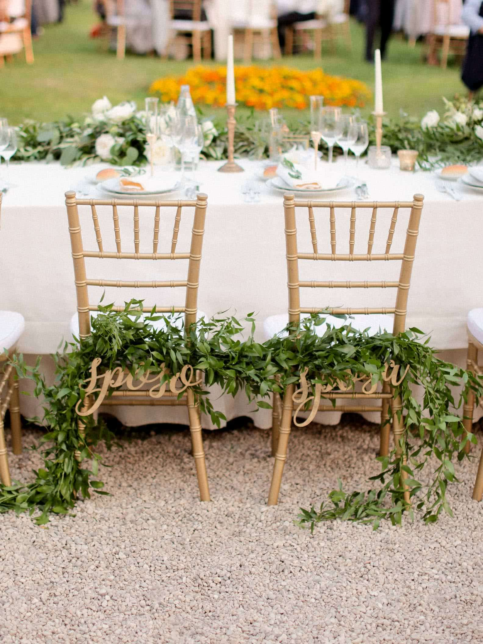 adorned chairs for bride and groom
