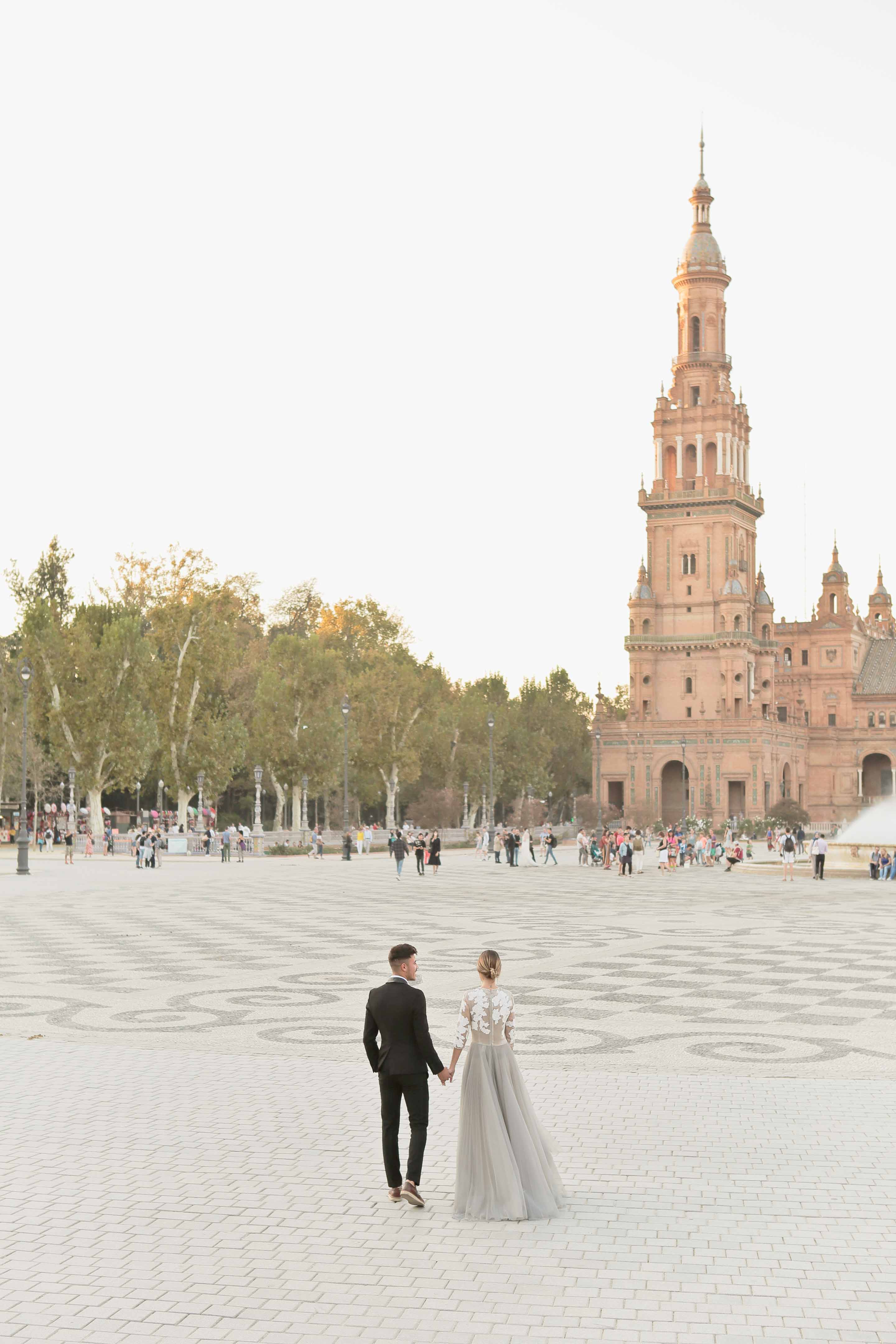 lovebirds in the desert plaza de espana in seville at sunset
