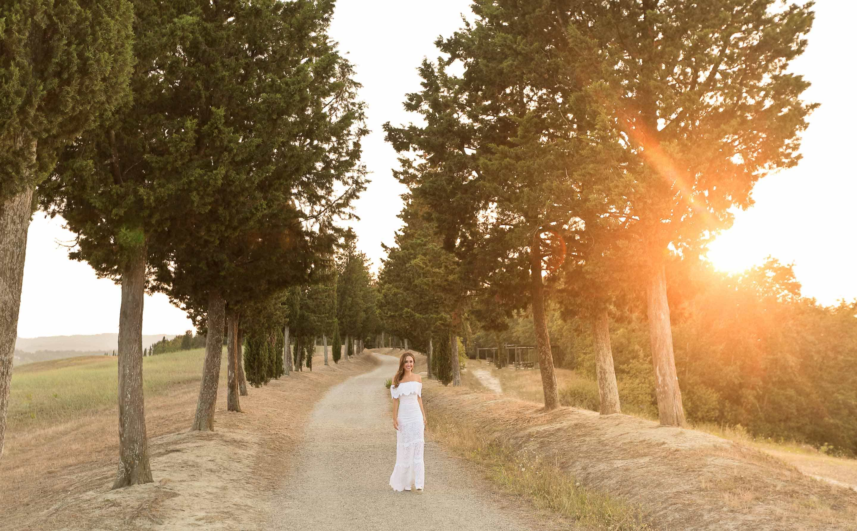girl walking in a unpaved road for her engagement session