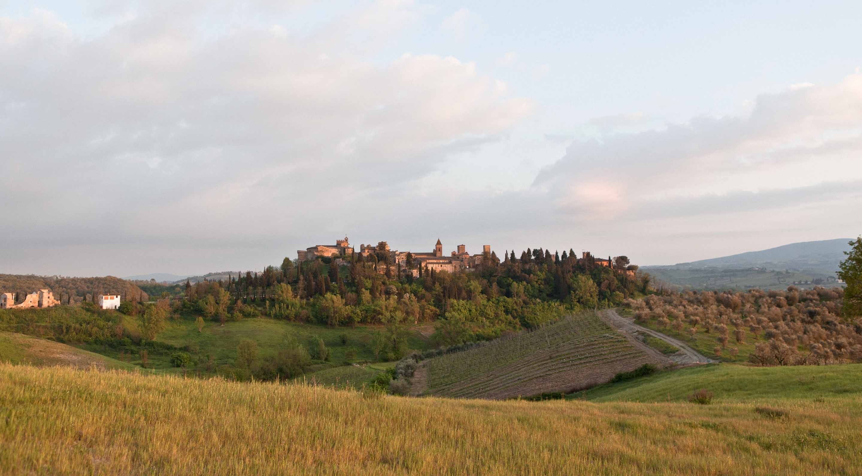 a village of tuscany at sunset