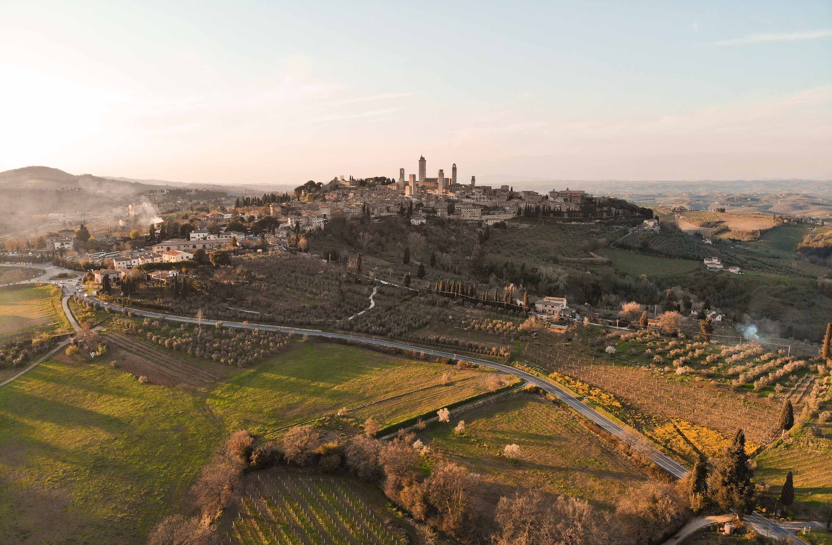 the village of san gimignano and its towers shot from above at sunset