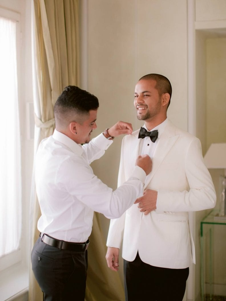 the groom is getting ready with his brother