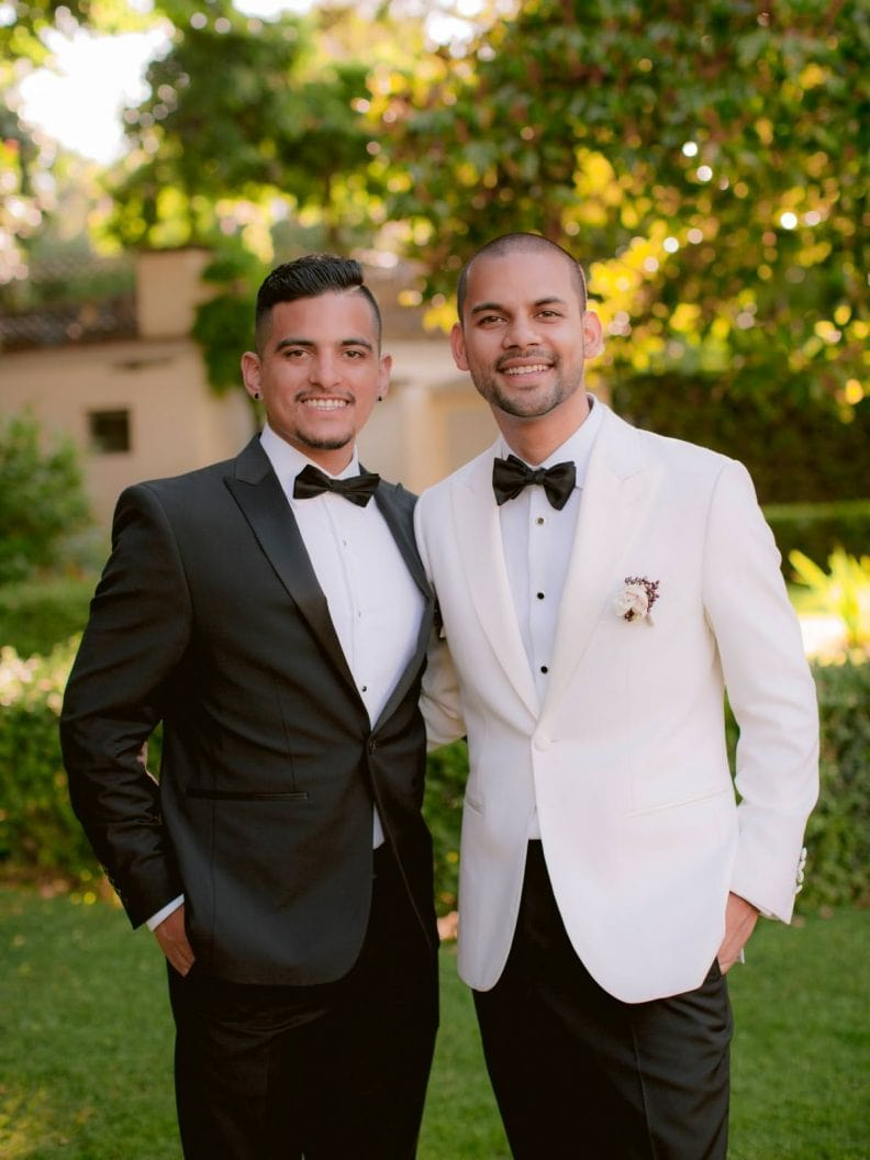 the groom is posing with his father