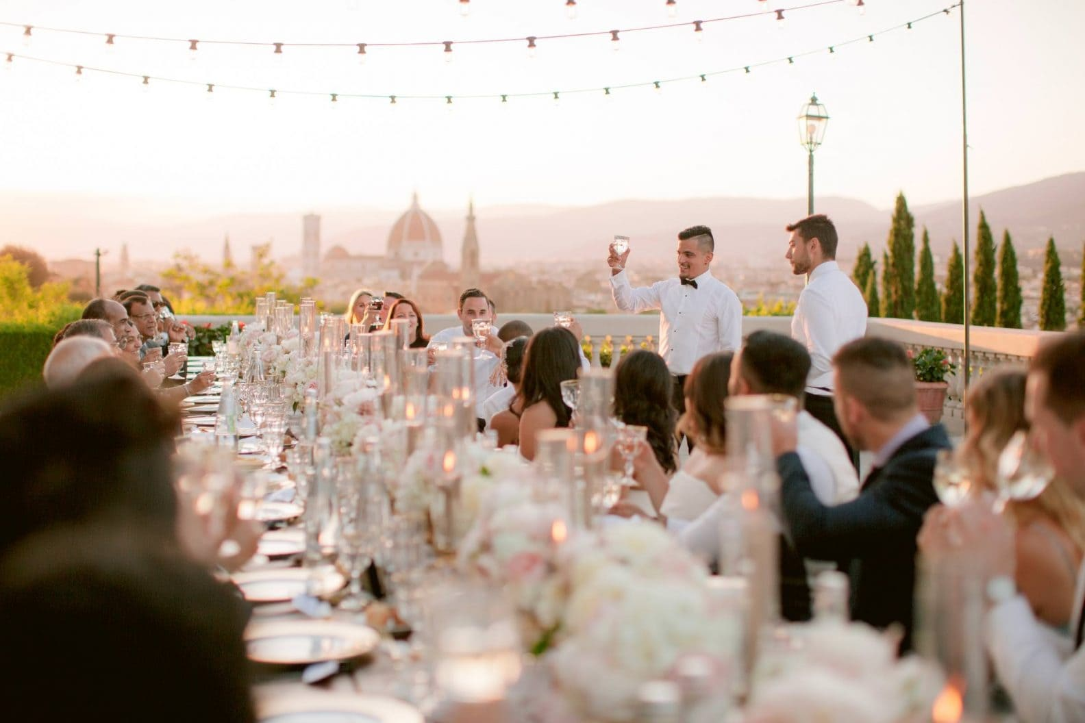 the wedding speeches during the dinner on the terrace of Villa la Vedetta