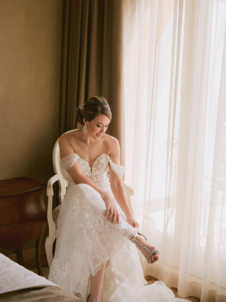 the bride is almost ready in her bridal suit on the lake garda