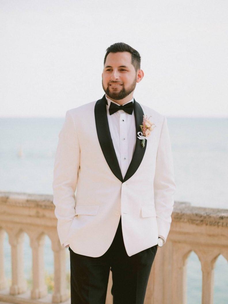 the elegant groom in his tuxedo