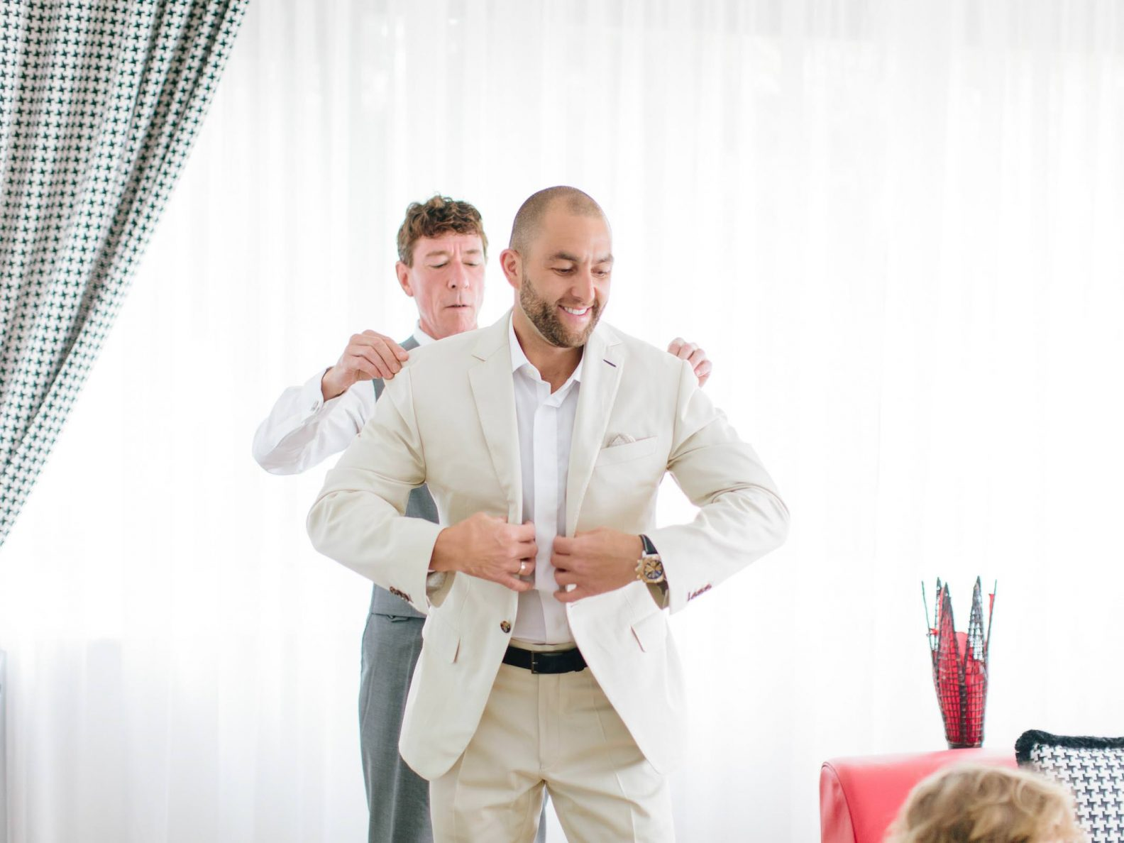 the groom is getting ready with his father