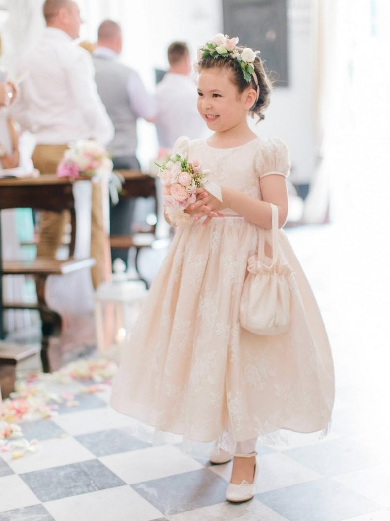 fower girl is walking down the aisle