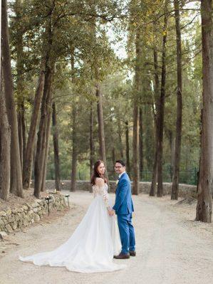 newlyweds posing for the wedding photographer