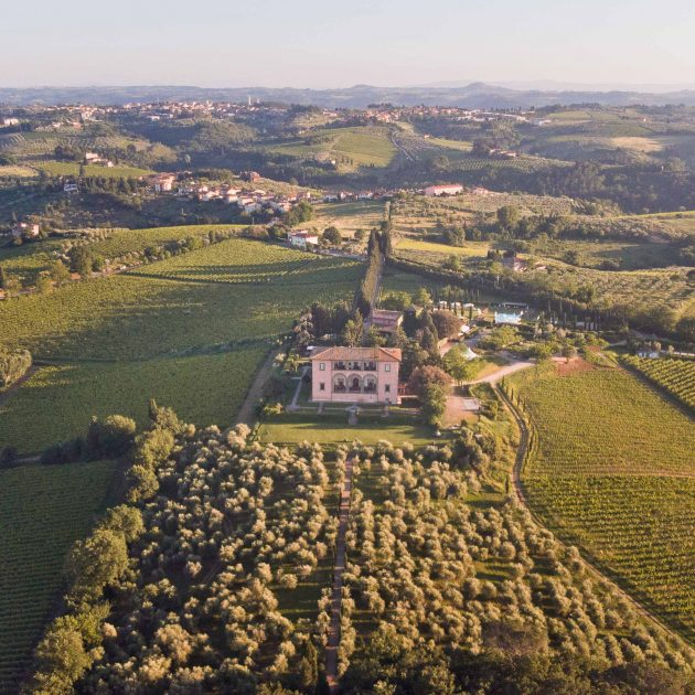aerial view of villa mangiacane with vineyards and olive groves of san casciano val di pesa all around
