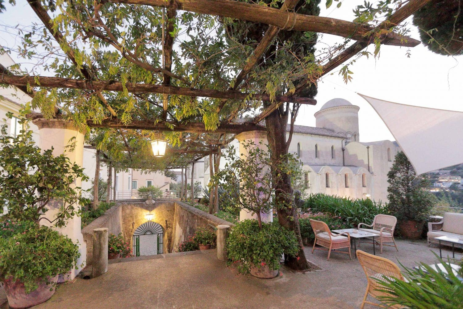 the entrance of the garden of belmond hotel caruso