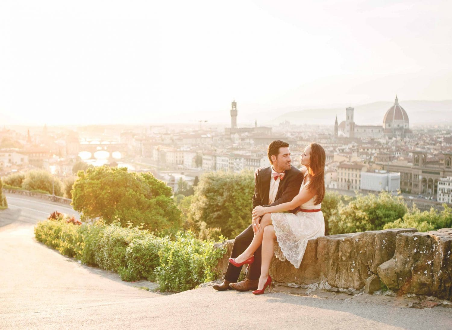 newlyweds having great time at sunset at piazzale michelangelo
