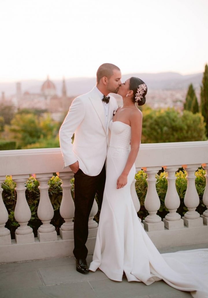 bride and groom on the terrace of the villa with the florentine Duomo in the background