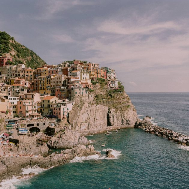 the view of manarola surronded by the ocean