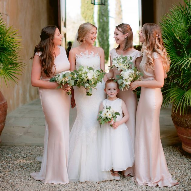 bride with her lovely bridesmaids and the flower girl