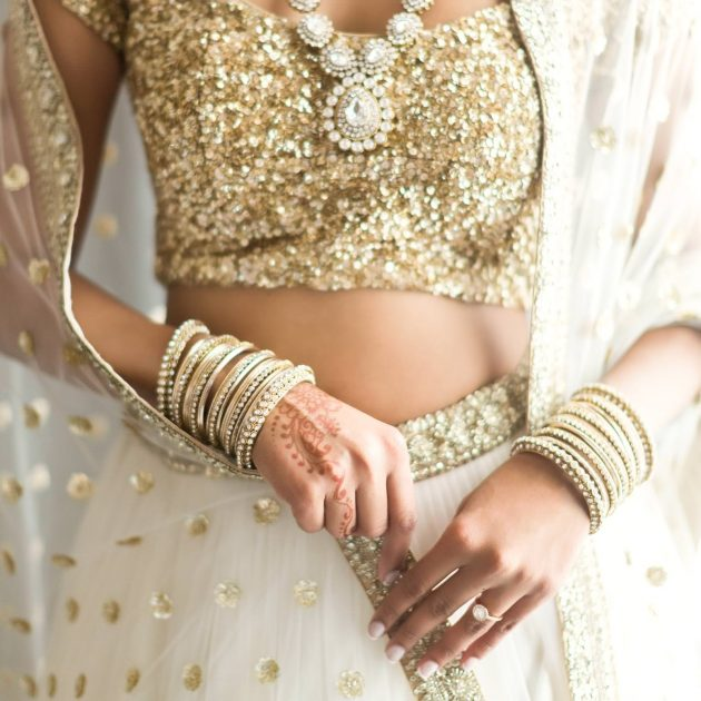 detail of the traditional indian dress of the bride